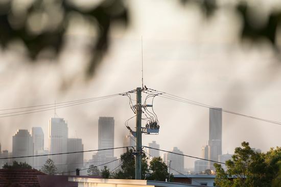 NOJA Power Recloser overlooking the Brisbane city skyline.