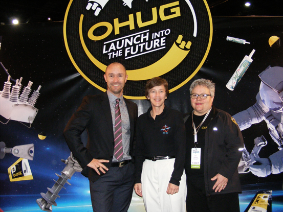 Retired NASA astronaut Wendy B. Lawrence (centre) on NOJA Power's NZ distributor OHUG's space-themed stand at the EEA Conference with Glenn Harris of NOJA Power and OHUG's Nan Russell