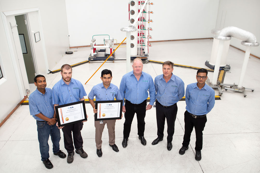 The NOJA Power Test Laboratory team celebrating their accreditation to IEC/ISO17025